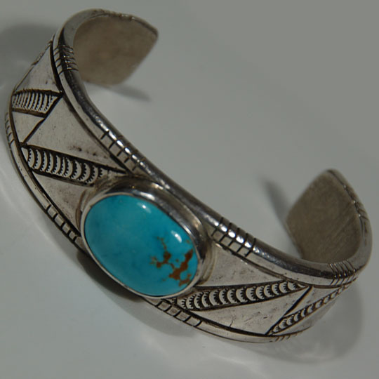 301336513593 further Navajo Native American Turquoise Inlay Yei Bracelet By Alexius also Sterling Silver St ed Bracelet With Turquoise Cabochon additionally 19632948348747848 also Oscar Alexius Spectacular Number Eight Turquoise Cross. on oscar alexius silver bracelets