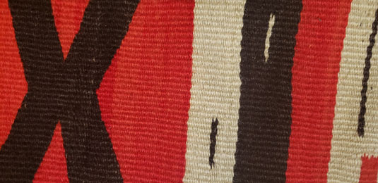 Close up view of a section of this textile.