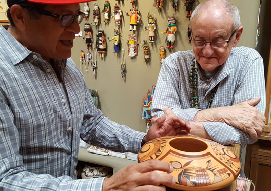 Mark Tahbo discussing his birds on Pueblo pottery.