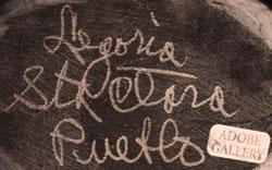 Artist Signature - Legoria Tafoya, Santa Clara Pueblo Potter