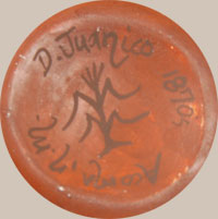 Delores creates miniature pottery and applies designs from published historic pottery.  This jar has a design she chose from a published Acoma jar from circa 1970s.  She acknowledges this by putting the date of the original jar on the bottom of her jar.  The design on this jar is from the book The Pottery of Acoma Pueblo by Harlow and Lanmon.