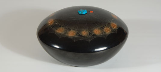 The center of the dome features a large spider with coral for the head and turquoise for the body.