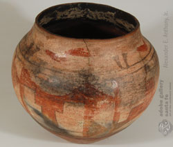 This Santa Ana jar is a rescued chimney jar.  The lower 1/3rd of the jar was broken off and the jar then added to the chimney of the pueblo house.  There is ample soot inside the jar as evidence.