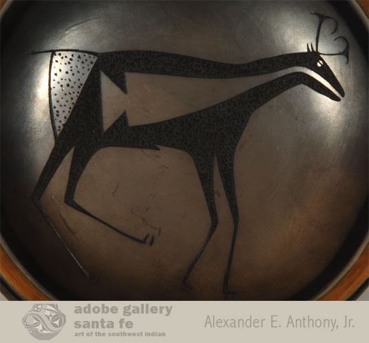 Close up view of the sgraffito antelope design.