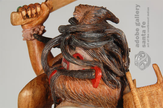 Close up view: One is immediately drawn to the hair of the doll which drapes over her face and is a maze of complicated swirls behind her head.  Pochoema said each grouping of hair is from the original wood, none being added or glued in place.  It appears nearly impossible to carve such a maze of tangles, but he did it.