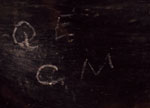 The initials Q. E. and C. M. were painted on the sidewall with matte black pigment.