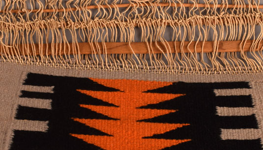 Close up view of the textile loom.