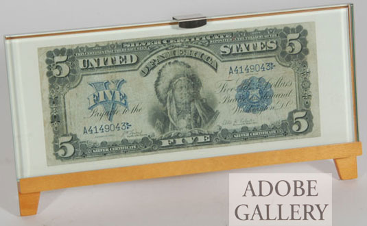 This Official 1899 United States Five Dollar Silver Certificate comes with a protective stand and glass overlay.