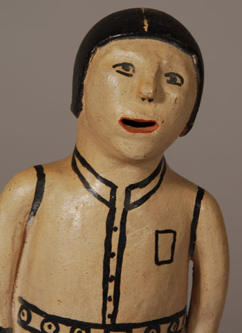 "This standing male figurine originally had the artist's name in pencil but it is too faint to read.  The only readable part is the date 1971.  It is possibly by Felipa Trujillo, an assumption based on the style of hands and the eyes.  Babcock states that Trujillo began making storyteller figurines in the mid-1960s.  We know that Cordero made the first one in 1964, so Trujillo must not have been far behind her.  Trujillo was one of the seven artists represented in the Museum of International Folk Art exhibit ""What is Folk Art?"" in 1973.  It seems fairly obvious that Trujillo was one of the earliest potters to make storyteller figurines.  Before storyteller figurines, Trujillo was making other figurines, both human and animal, so it is not unlikely that this male figurine could be one of her creations.  Condition:  the figurine is in original condition  Provenance: from the collection of Katherine H. Rust  Recommended Reading: The Pueblo Storyteller by Barbara A. Babcock"