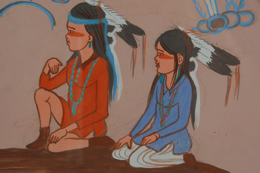 In this painting of an elder Diné, with young children gathered by him, we are reminded that there was a time when stories about great deeds of the past were verbally relayed to the younger generation.