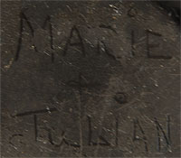 Maria had a very distinctive signature when writing her and Julian's names and it varied little, if at all, during her long career.  This jar does not bear the handwriting of Maria.  It does not mean that Maria did not make the jar and that Julian did not paint the design, it only means that another member of the family may have signed the jar with their names because perhaps Maria was occupied with making pottery or entertaining tourists.