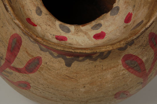 Inside the neck is a support of the type seen with jars that have lids but there are no wear patterns to indicate that this jar ever had a lid.