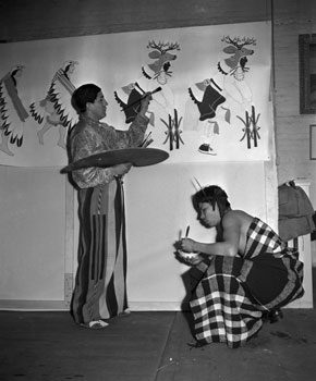 Painting mural for the U.S. Office of Indian Affairs at the Exposition, 1939. Source Unknown.  Original caption: 01/07/1939-SAN FRANCISCO, CA: Joe Evans Duran (RT) and Ignacio Moquino (LT) working on murals for the Indian room of the new Federal ...