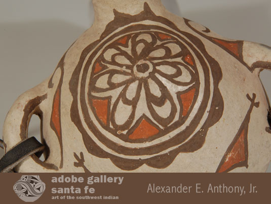 This rosette is the same design used on most Zuni Polychrome jars.  Presumably, it is a design influence from the medallions seen on Spanish men's clothing.