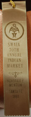 RIBBON - .  The jar was awarded an Honorable Mention at the Santa Fe Indian Market in 1991.