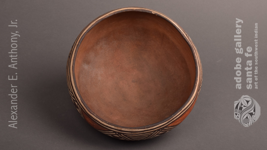 Inside of this Isleta Pueblo Polychrome Small Serving Bowl
