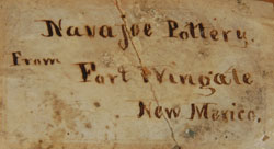 Beautifully written in cursive script on a paper attached to the base is Navajoe Pottery from Fort Wingate New Mexico.