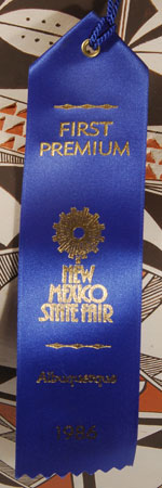 She must have made this specifically for entry in the New Mexico State Fair in 1986.  She was rewarded for that effort as it was awarded First Premium that year.  Now, 30 years later, we have the pleasure to offer it at our Santa Fe gallery.