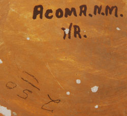 The underside is signed Acoma, N.M. and with the initials HR in fired-on text and $2.50 in pencil.
