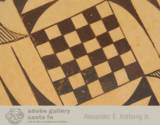 The artist decorated only the interior. At the center of the bowl is a checkerboard design, believed to represent the planting fields. Surrounding this are semi-circle elements filled with fine lines, clouds conceivably representing rain, desperately needed for the crops.