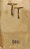 TT, the hallmark initials of Thomas (Tommy) Tso, a Navajo craftsman