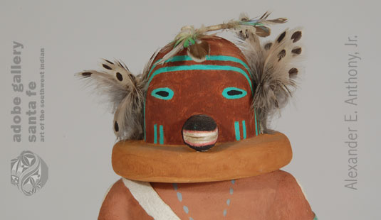 Close up view of this Katsina Doll's face.