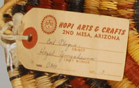 This plaque still has attached the Hopi Arts & Crafts tag with the weaver's name.