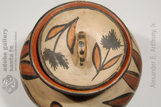 It's rare to see any Pueblo pottery with a lid - and that the lid is still with the original vessel and it's intact.