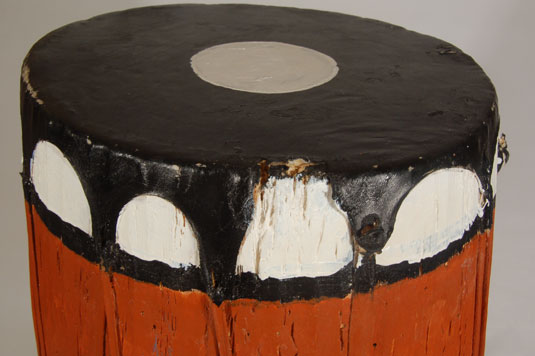 Condition: a slight tear exists at the edge of the top leather drum head but does not affect the sound of the drum.