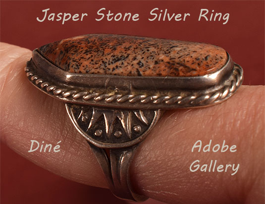 Alternate view of this ring being worn showing side designs in the silver.