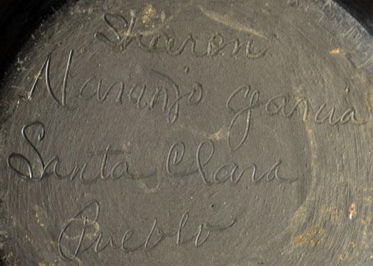 The jar is signed Sharon Naranjo Garcia Santa Clara Pueblo on the underside.