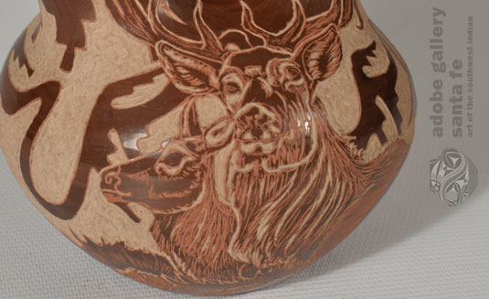 Close up view of the Deer image on the side of this vessel.