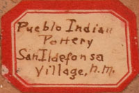 """An old eight-sided paper label on the underside of the vessel, written in beautiful old script, reads """"Pueblo Indian Pottery San Ildefonso Village, N.M."""" The vessel dates to the early 1900s."""
