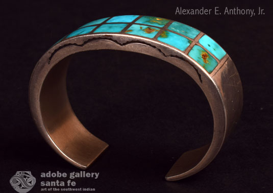 Alternate side view of this bracelet with stamping in the silver.