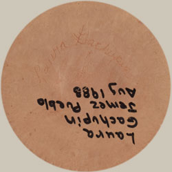 Artist Signature - Laura Gachupin, Jemez Pueblo Potter.  Her signature is engraved seen here right side up.  Later, someone added a marker with her information in the other direction.