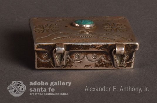 Alternate view of the back of this silver box showing the hinges.