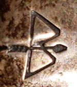 Ike Wilson (1900-1942) hallmark signature of bow and arrow symbol.