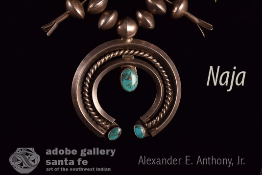 At the bottom of the necklace hangs a naja, the crescent shape borrowed from the Spanish by way of the Moors.