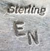 Artist Hallmark initials - Elvis Nelson, Diné Silversmith