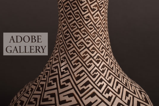 Alternate close up view of the neck designs on this pottery vase.