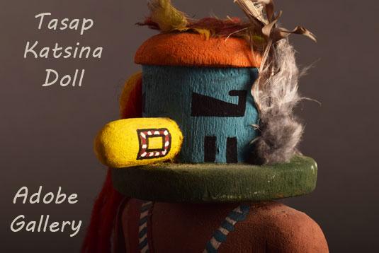 Close up view of the face of this Katsina Doll caving.