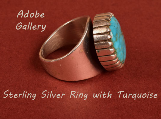 Alternate side view of this silver and turquoise ring.