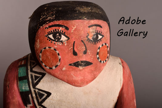 Close up view of the face of this social dancer carving.
