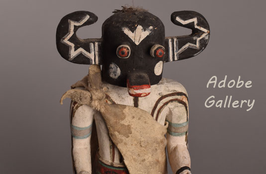 Close up view of the kachina doll face.