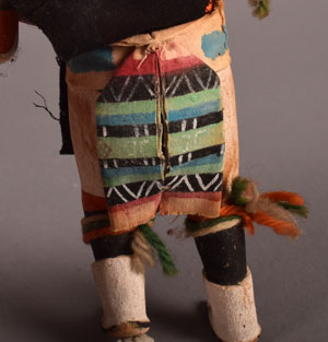 The painted sash under the black loin cloth on the back of the dancer is painted fabric.