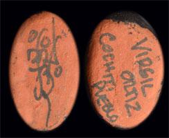 Artist Signature on the pads of the feet of this figurine - Virgil Ortiz, Cochiti Pueblo Potter
