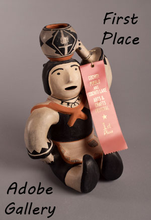 Louis Naranjo entered this figurine in the 1982 Cochiti Pueblo and Cochiti Lake Arts and Crafts Festival where it was awarded a First Place.