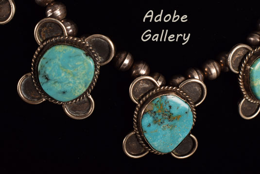 Close up view of a section of this silver and turquoise necklace