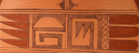 Close-up view of the designs of this pottery tile.