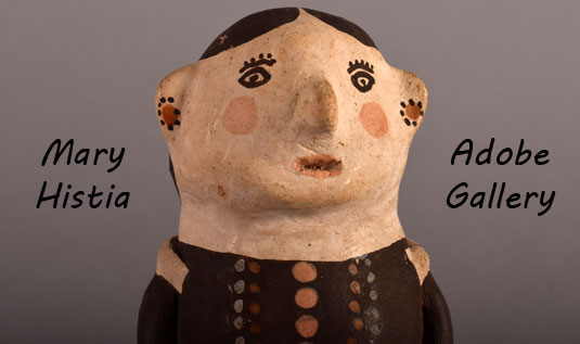 Close up view of the face of this pottery figurine.